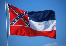 Original photo of the flag of Mississippi, USA, taken by the author of the post years ago to illustrate an essay in which he argued that the confederate symbol should be replaced in favor of something more inclusive.